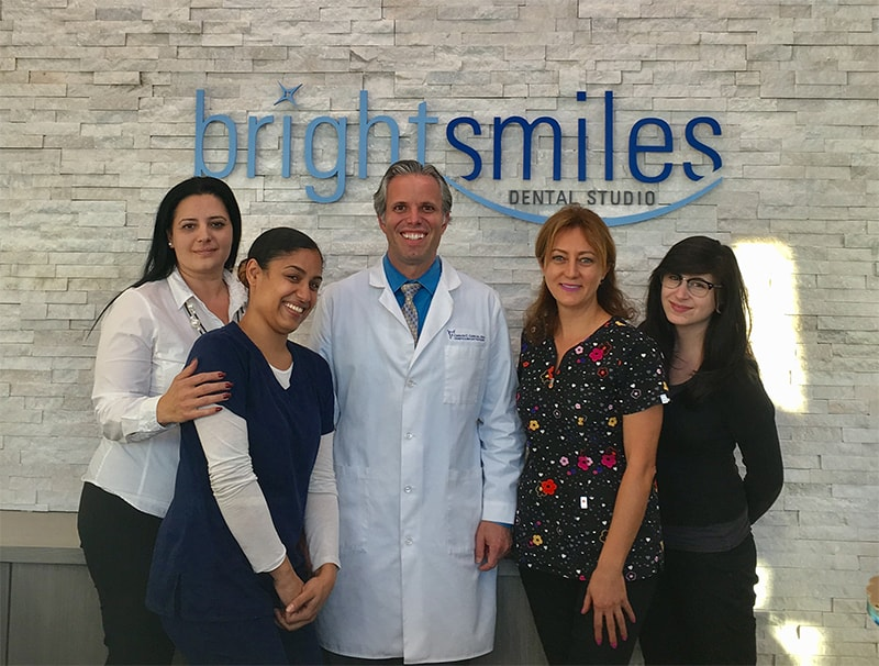 Dr. Carlos Garcia, Bright Smiles Dental Studio Image Of Dr.Carlos Garcia and Team