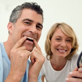 Dr. Carlos Garcia, Bright Smiles Dental Studio Image Of Smiling couple